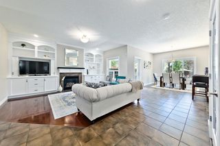 Photo 4: 125 COUGARSTONE Manor SW in Calgary: Cougar Ridge Detached for sale : MLS®# A1019561