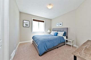 Photo 16: 125 COUGARSTONE Manor SW in Calgary: Cougar Ridge Detached for sale : MLS®# A1019561