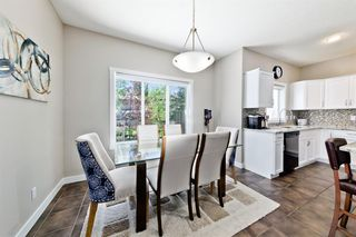 Photo 9: 125 COUGARSTONE Manor SW in Calgary: Cougar Ridge Detached for sale : MLS®# A1019561