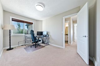 Photo 17: 125 COUGARSTONE Manor SW in Calgary: Cougar Ridge Detached for sale : MLS®# A1019561
