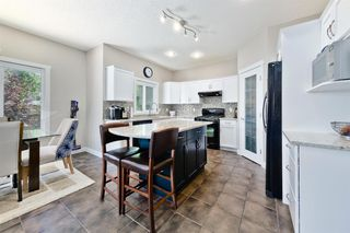 Photo 8: 125 COUGARSTONE Manor SW in Calgary: Cougar Ridge Detached for sale : MLS®# A1019561