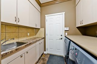 Photo 11: 125 COUGARSTONE Manor SW in Calgary: Cougar Ridge Detached for sale : MLS®# A1019561