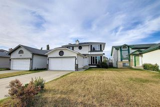 Photo 2: 110 RIVERGLEN Drive SE in Calgary: Riverbend Detached for sale : MLS®# A1030846