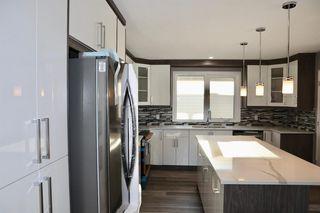 Photo 6: 1452 43 Street NE in Calgary: Marlborough Detached for sale : MLS®# A1050782