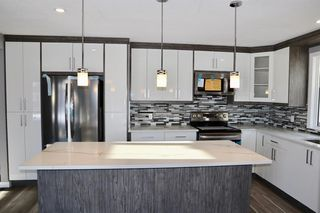 Photo 1: 1452 43 Street NE in Calgary: Marlborough Detached for sale : MLS®# A1050782