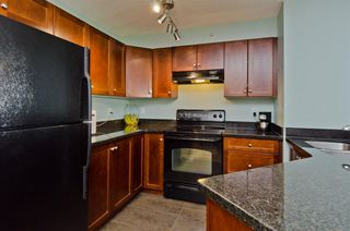 Photo 21: DOWNTOWN: Airdrie Apartment for sale