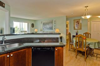 Photo 22: DOWNTOWN: Airdrie Apartment for sale