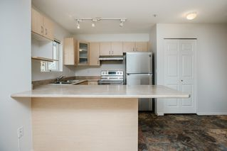 "Photo 5: 210 6359 198 Street in Langley: Willoughby Heights Condo for sale in ""Rosewood"" : MLS®# R2497208"