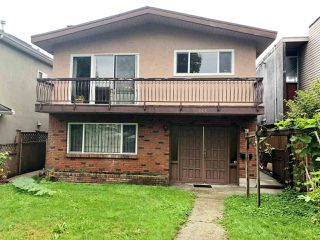 Photo 1: 3166 E 1ST Avenue in Vancouver: Renfrew VE House for sale (Vancouver East)  : MLS®# R2405003