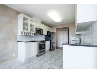 "Photo 6: 604 15466 NORTH BLUFF Road: White Rock Condo for sale in ""THE SUMMIT"" (South Surrey White Rock)  : MLS®# R2420204"