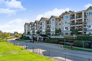 "Main Photo: 112 19673 MEADOW GARDENS Way in Pitt Meadows: North Meadows PI Condo for sale in ""THE FAIRWAYS"" : MLS®# R2434508"