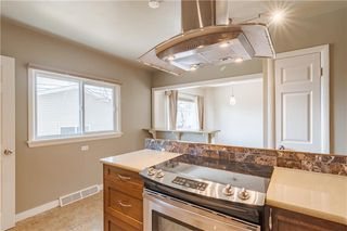 Photo 5: 37 CADOGAN Road NW in Calgary: Cambrian Heights Detached for sale : MLS®# C4294170