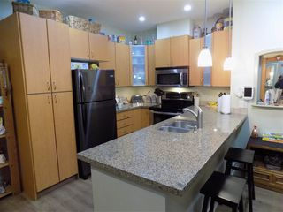 "Photo 2: 205 33485 SOUTH FRASER Way in Abbotsford: Central Abbotsford Condo for sale in ""CITADEL RIDGE"" : MLS®# R2490166"