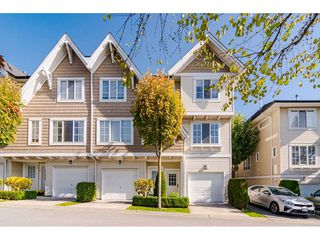 """Photo 1: 28 20560 66 Avenue in Langley: Willoughby Heights Townhouse for sale in """"Amberleigh 2"""" : MLS®# R2506602"""