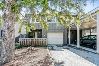 Photo 2: 7 2225 OAKMOOR Drive SW in Calgary: Palliser Row/Townhouse for sale : MLS®# C4302419