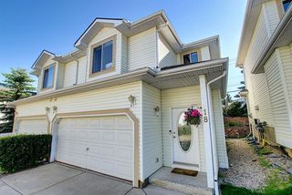 Main Photo: 18 35 Patterson Hill SW in Calgary: Patterson Semi Detached for sale : MLS®# A1043439