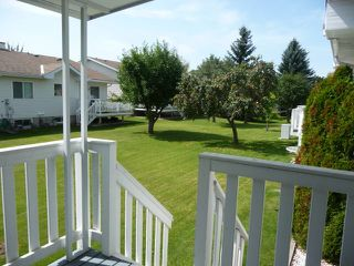 Photo 3: 33 9704 165 Street NW in Edmonton: Zone 22 House Half Duplex for sale : MLS®# E4168475