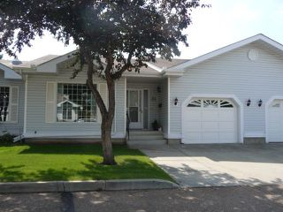 Photo 1: 33 9704 165 Street NW in Edmonton: Zone 22 House Half Duplex for sale : MLS®# E4168475