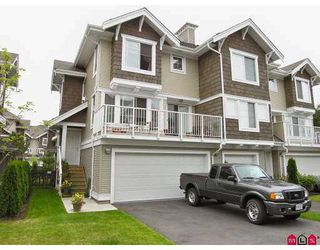 "Photo 1: 67 20760 DUNCAN WY in Langley: Langley City Townhouse for sale in ""Wyndham Lane"" : MLS®# F2618219"