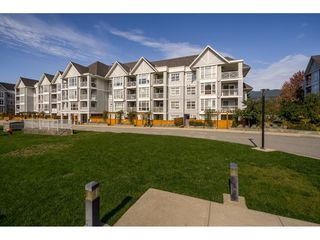 "Photo 1: 109 3142 ST JOHNS Street in Port Moody: Port Moody Centre Condo for sale in ""Sonrisa"" : MLS®# R2409671"
