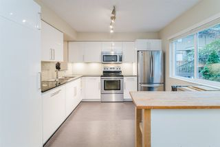"Photo 1: B 323 EVERGREEN Drive in Port Moody: College Park PM Townhouse for sale in ""The Evergreens"" : MLS®# R2425936"