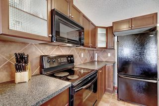 Photo 12: 115 ROYAL BIRCH MT NW in Calgary: Royal Oak Row/Townhouse for sale : MLS®# C4276537