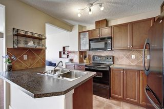 Photo 8: 115 ROYAL BIRCH MT NW in Calgary: Royal Oak Row/Townhouse for sale : MLS®# C4276537