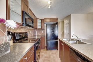 Photo 11: 115 ROYAL BIRCH MT NW in Calgary: Royal Oak Row/Townhouse for sale : MLS®# C4276537