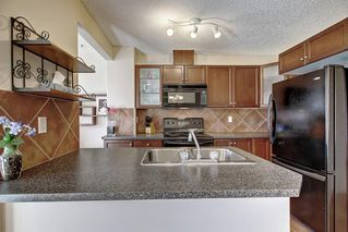 Photo 9: 115 ROYAL BIRCH MT NW in Calgary: Royal Oak Row/Townhouse for sale : MLS®# C4276537
