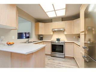 """Photo 9: 304 6440 197 Street in Langley: Willoughby Heights Condo for sale in """"The Kingsway"""" : MLS®# R2480168"""