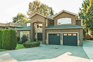"""Photo 1: 3623 PHILLIPS Avenue in Burnaby: Government Road House for sale in """"Government Road"""" (Burnaby North)  : MLS®# R2497788"""