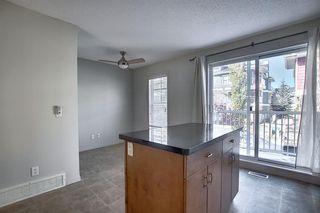 Photo 5: 23 Auburn Bay Common SE in Calgary: Auburn Bay Row/Townhouse for sale : MLS®# A1043994