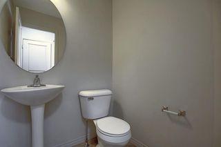 Photo 12: 23 Auburn Bay Common SE in Calgary: Auburn Bay Row/Townhouse for sale : MLS®# A1043994