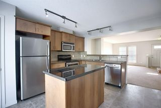 Photo 4: 23 Auburn Bay Common SE in Calgary: Auburn Bay Row/Townhouse for sale : MLS®# A1043994