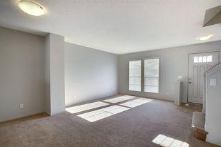Photo 11: 23 Auburn Bay Common SE in Calgary: Auburn Bay Row/Townhouse for sale : MLS®# A1043994