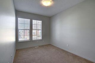 Photo 19: 23 Auburn Bay Common SE in Calgary: Auburn Bay Row/Townhouse for sale : MLS®# A1043994