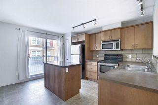 Photo 3: 23 Auburn Bay Common SE in Calgary: Auburn Bay Row/Townhouse for sale : MLS®# A1043994