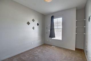 Photo 17: 23 Auburn Bay Common SE in Calgary: Auburn Bay Row/Townhouse for sale : MLS®# A1043994