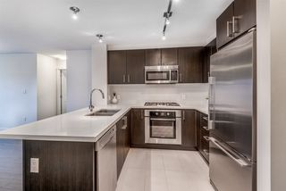 """Photo 3: 321 3133 RIVERWALK Avenue in Vancouver: South Marine Condo for sale in """"New Water"""" (Vancouver East)  : MLS®# R2429695"""