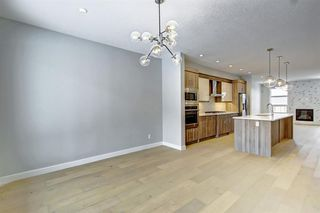 Photo 5: 632 17 Avenue NW in Calgary: Mount Pleasant Semi Detached for sale : MLS®# A1058281