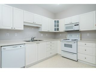 "Photo 11: 310 5677 208 Street in Langley: Langley City Condo for sale in ""IVY LEA"" : MLS®# R2386704"