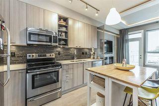 "Photo 6: 516 3080 GLADWIN Road in Abbotsford: Central Abbotsford Condo for sale in ""Hudson's Loft"" : MLS®# R2404594"