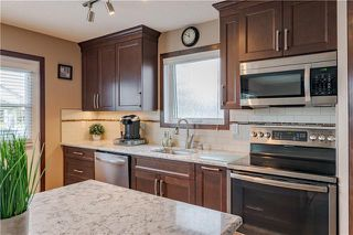 Photo 9: 129 ARBOUR RIDGE Circle NW in Calgary: Arbour Lake Detached for sale : MLS®# C4302684