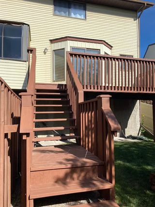 Photo 31: 554 STRATHCONA Drive SW in Calgary: Strathcona Park Semi Detached for sale : MLS®# A1020759