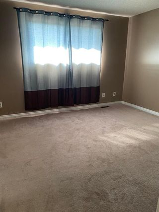 Photo 17: 554 STRATHCONA Drive SW in Calgary: Strathcona Park Semi Detached for sale : MLS®# A1020759