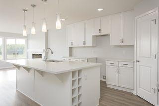 Photo 3: 663 Eagleson Crescent in Edmonton: Zone 57 House Half Duplex for sale : MLS®# E4175878