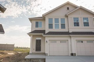 Photo 1: 663 Eagleson Crescent in Edmonton: Zone 57 House Half Duplex for sale : MLS®# E4175878