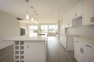 Photo 2: 663 Eagleson Crescent in Edmonton: Zone 57 House Half Duplex for sale : MLS®# E4175878