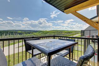 Photo 7: 1001 Jumping Pound Common in Cochrane: House for sale : MLS®# c4248929