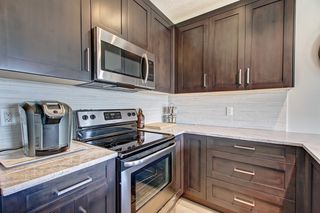 Photo 4: 1001 Jumping Pound Common in Cochrane: House for sale : MLS®# c4248929